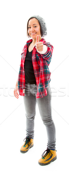 Young woman showing thumbs up sign and smiling Stock photo © bmonteny