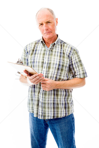 Senior man holding a clipboard Stock photo © bmonteny