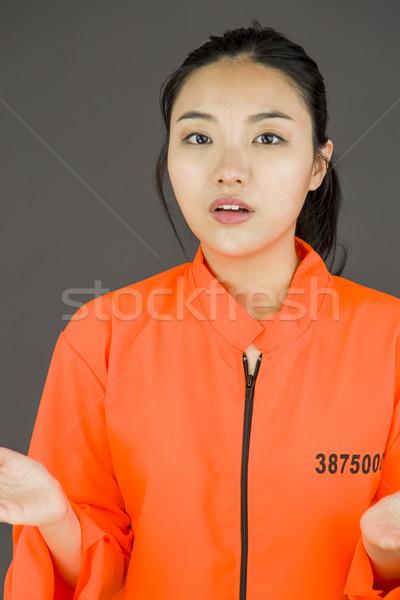 Jovem asiático mulher uniforme laranja lei Foto stock © bmonteny