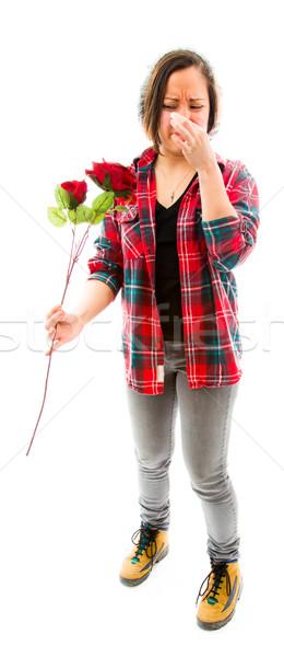 Fiatal nő orr tart rózsa fiatal felnőtt kaukázusi Stock fotó © bmonteny