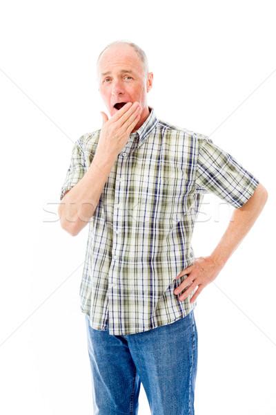 Senior man naar geschokt portret shirt Stockfoto © bmonteny