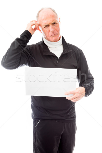 Senior man holding a blank placard and scratching his head Stock photo © bmonteny