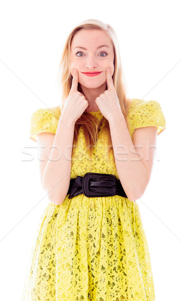 Beautiful young woman standing and showing smiley face Stock photo © bmonteny