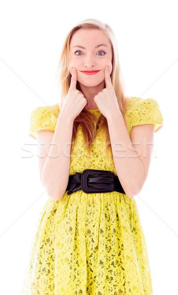 Gyönyörű fiatal nő áll mutat mosolygós arc jókedv Stock fotó © bmonteny