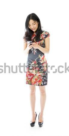 Asya genç kadın cep telefonu kadın ayakkabı Stok fotoğraf © bmonteny