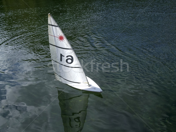 Sailboat moving in a lake Stock photo © bmonteny