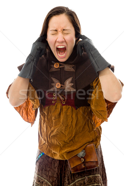 Stock photo: Young woman shouting with fingers in her ears
