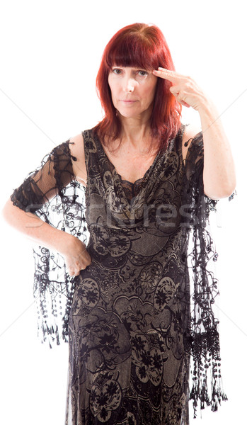 Mature woman holding her finger against her head Stock photo © bmonteny