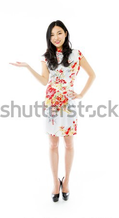 Asian young woman showing thumbs up from both hands isolated on white background Stock photo © bmonteny