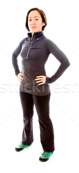 Young woman standing with her arms akimbo Stock photo © bmonteny