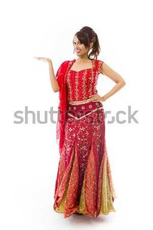 Stock photo: Young Indian woman standing with finger on lips