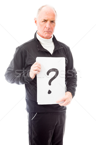 Senior man holding question mark sign Stock photo © bmonteny