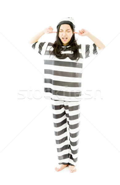 Stock photo: Young Asian woman shouting in frustration in prisoners uniform