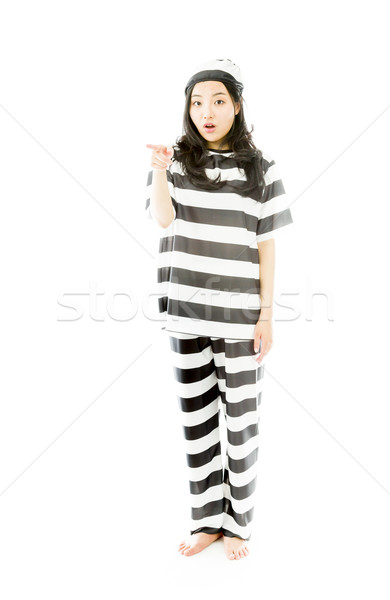 Young Asian woman pointing and looking shocked in prisoners uniform Stock photo © bmonteny