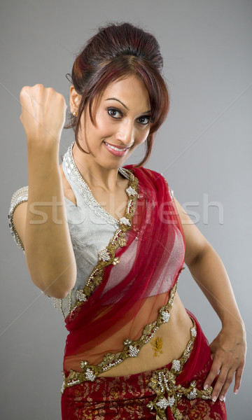 Stock photo: Young Indian woman celebrating success