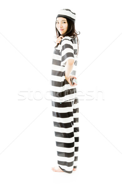 Young Asian woman holding a mobile phone in prisoners uniform Stock photo © bmonteny