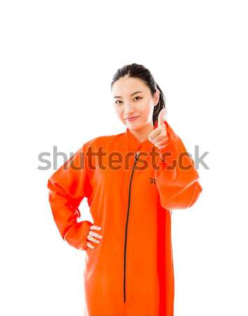 Young Asian woman showing thumb up sign in prisoners uniform Stock photo © bmonteny