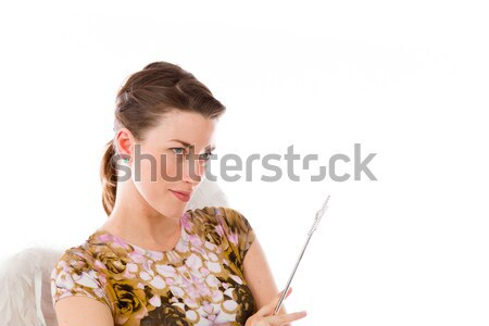 Young woman suffering from headache and holding teddy bear Stock photo © bmonteny