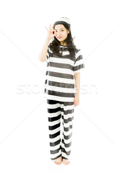 Young Asian woman showing OK sign in prisoners uniform Stock photo © bmonteny