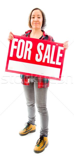 Elarusítónő mutat vásár felirat fiatal felnőtt kaukázusi Stock fotó © bmonteny