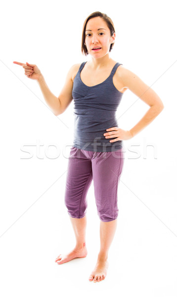 Young woman standing and showing something Stock photo © bmonteny