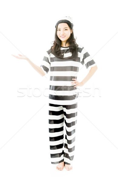 Young Asian woman showing product with open hand palm in prisoners uniform Stock photo © bmonteny