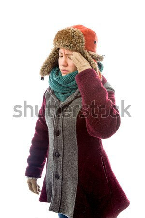 Young woman in warm clothing suffering from headache Stock photo © bmonteny