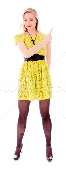 美しい 若い女性 ポインティング 戻る 立って 方向 ストックフォト © bmonteny