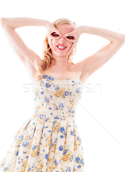 Beautiful young woman standing with her hands around her eyes Stock photo © bmonteny