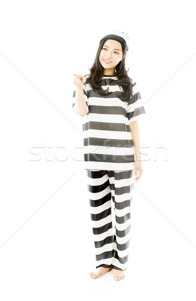 Young Asian woman showing something in prisoners uniform Stock photo © bmonteny
