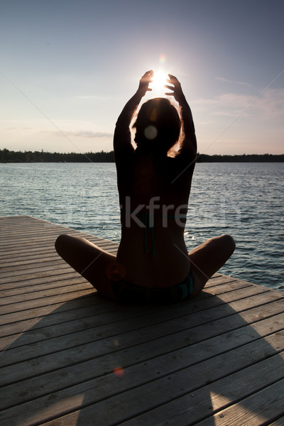 Silhouette of a woman practicing yoga at a pier, Georgian Bay, T Stock photo © bmonteny