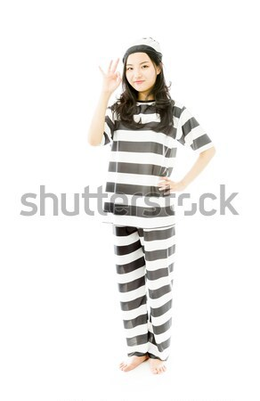 Young Asian woman celebrating success in prisoners uniform Stock photo © bmonteny