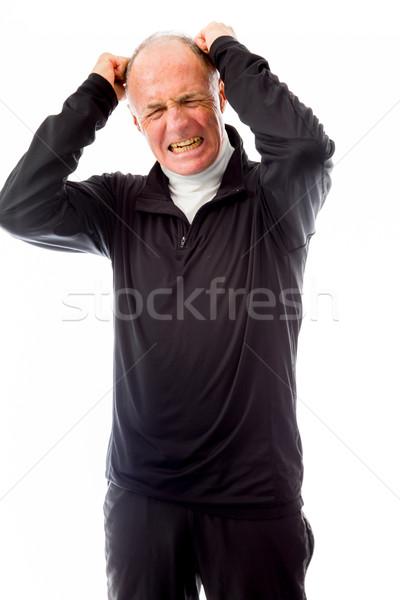 Senior homem cabelo gritando frustração Foto stock © bmonteny