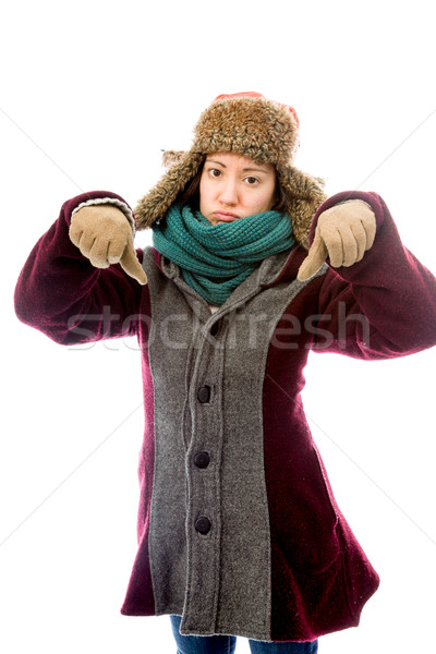 Young woman in warm clothing and showing thumbs down sign with b Stock photo © bmonteny
