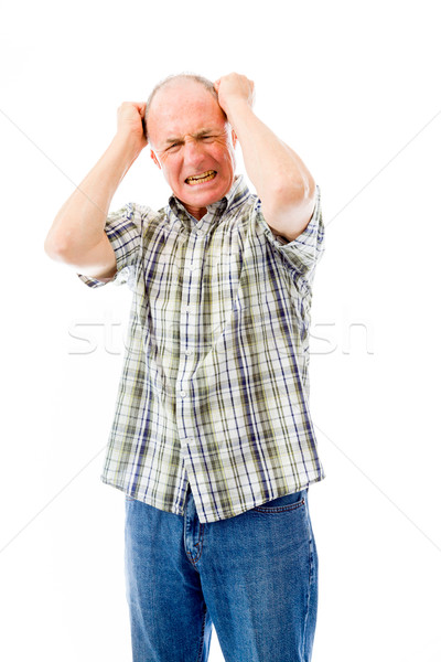 Senior man pulling his hair and screaming in frustration Stock photo © bmonteny