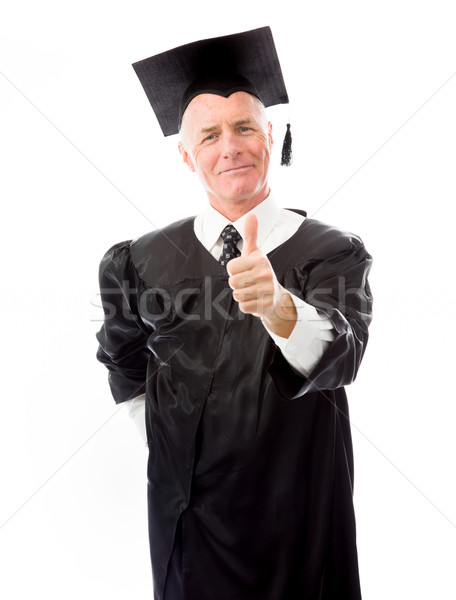Stock photo: Portrait of a senior male graduate making thumbs up sign