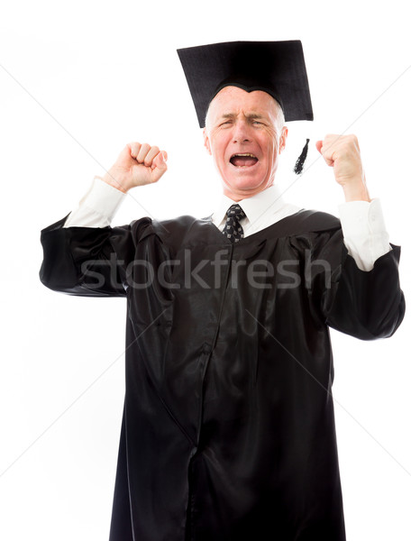Senior male graduate celebrating his success Stock photo © bmonteny
