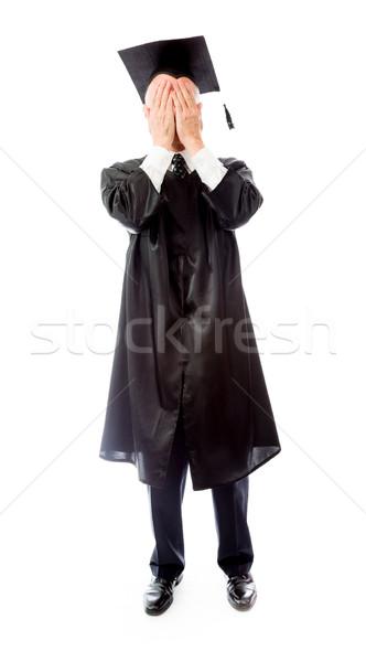 Senior male graduate hiding his face Stock photo © bmonteny