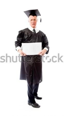Stressed senior male graduate holding a blank placard Stock photo © bmonteny