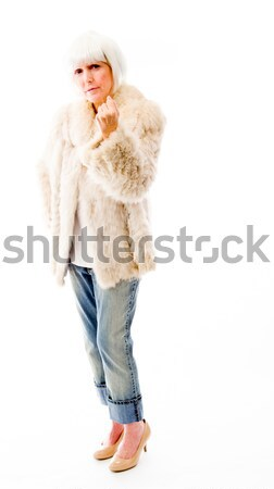 Senior woman with a finger on lips Stock photo © bmonteny