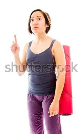 Fiatal nő hordoz testmozgás mutat ujj felfelé Stock fotó © bmonteny