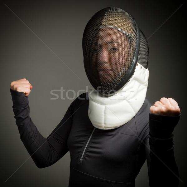 Female fencer in fencing mask with punching the air Stock photo © bmonteny