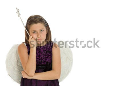 Young Indian woman standing with finger on lips Stock photo © bmonteny