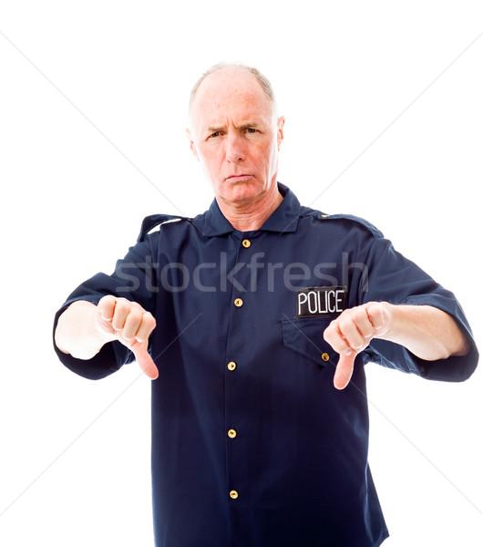 Rendőr készít hüvelykujjak lefelé kézmozdulat kék Stock fotó © bmonteny