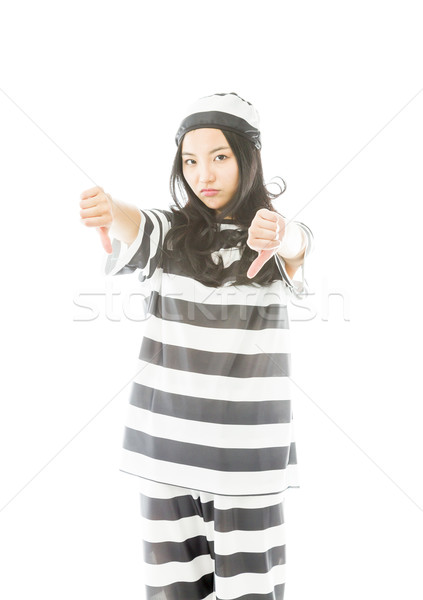 Young Asian woman showing thumbs down sign from both hands in prisoners uniform Stock photo © bmonteny