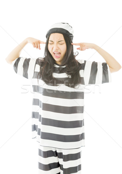 Young Asian woman shouting in frustration in prisoners uniform Stock photo © bmonteny