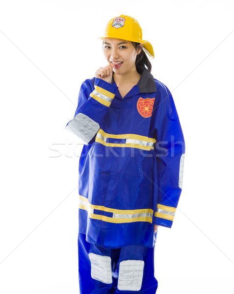 Lady firefighter with finger in mouth Stock photo © bmonteny