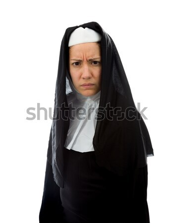 Young nun thinking with her hand on chin Stock photo © bmonteny