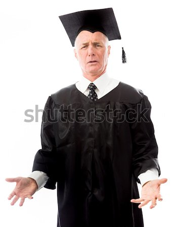 Senior male graduate with finger on lips isolated on white backg Stock photo © bmonteny