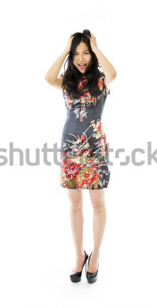 Frustrated Asian young woman screaming pulling her hair Stock photo © bmonteny